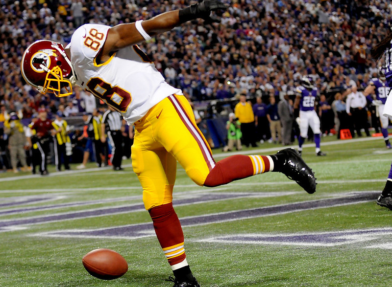 . Washington Redskins wide receiver Pierre Garcon spins the ball  in the end zone after scoring a touchdown during the first quarter. (Pioneer Press: Sherri LaRose-Chiglo)