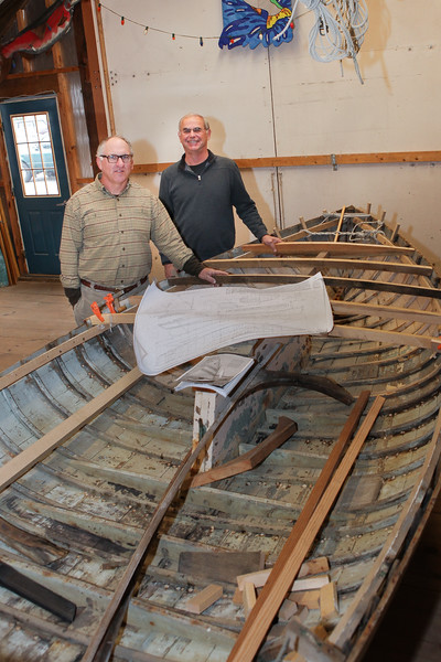 Peter Aremstam, Jones River Landing Boatshop Director and volunteer Matt Murray, are in the process of rebuilding a 1960s model Beatle Cat.  Proceeds from its sale will go towards the building of a replica of 1885 Kingston lobster oat. Wicked Local Photo/Denise Maccaferri