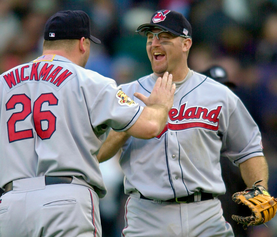 . Cleveland Indians closing pitcher Bob Wickman, left, celebrates with first baseman Jim Thome after beating the Seattle Mariners 5-0 in Game 1 of the American League Division Series Tuesday, Oct. 9, 2001 photo, at Safeco Field in Seattle. (AP Photo/Kim D. Johnson)