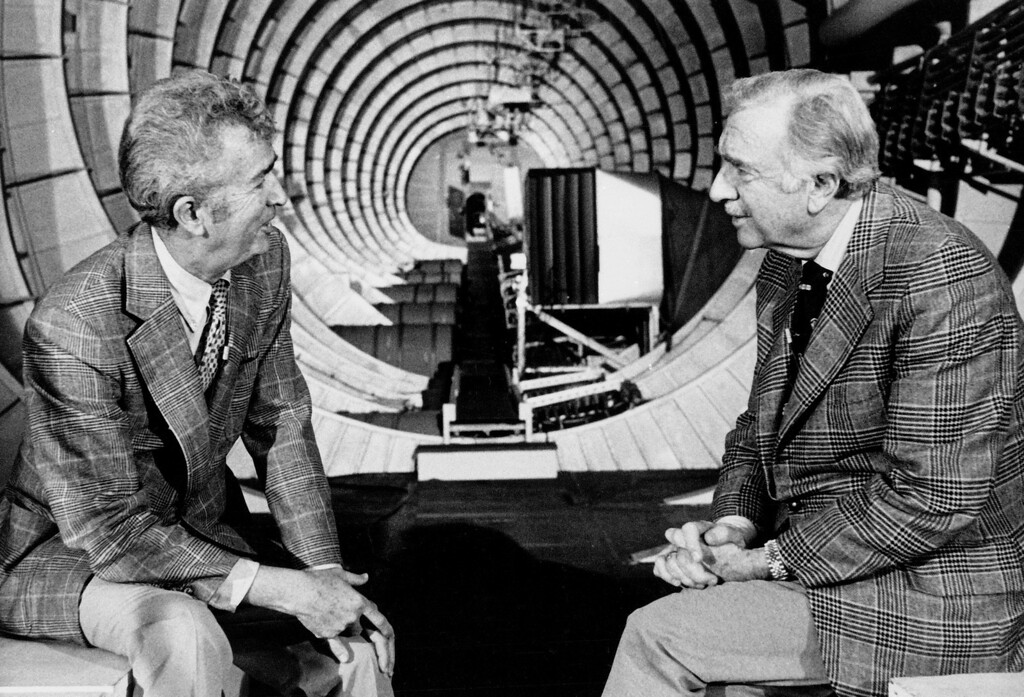 ". Jack Real, Senior Vice-president of Summa Corp. Aviation Group, Left, is interviewed by CBS News correspondent Walter Cronkite inside the hull of Howard Hughes\' Flying Boat, the ""Spruce Goose,\"" in its hanger at Long Beach, Calif Feb. 27, 1978. (AP Photo)"