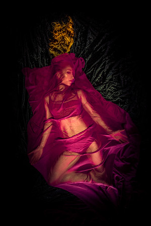 involvement of a dancer under red satin sheets