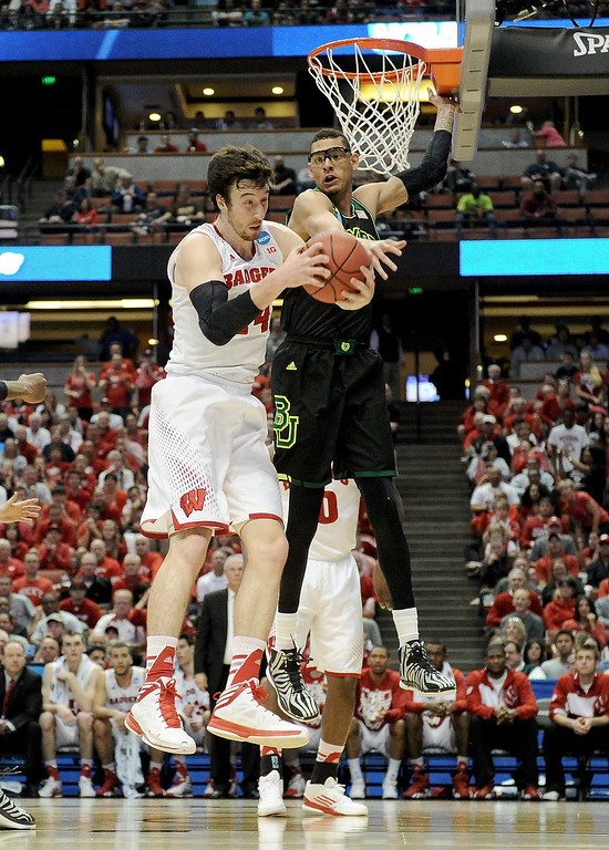 . Frank Kaminsky #44 of the Wisconsin Badgers grabs a rebound against Isaiah Austin #21 of the Baylor Bears in the first half during the regional semifinal of the 2014 NCAA Men\'s Basketball Tournament at the Honda Center on March 27, 2014 in Anaheim, California.  (Photo by Harry How/Getty Images)