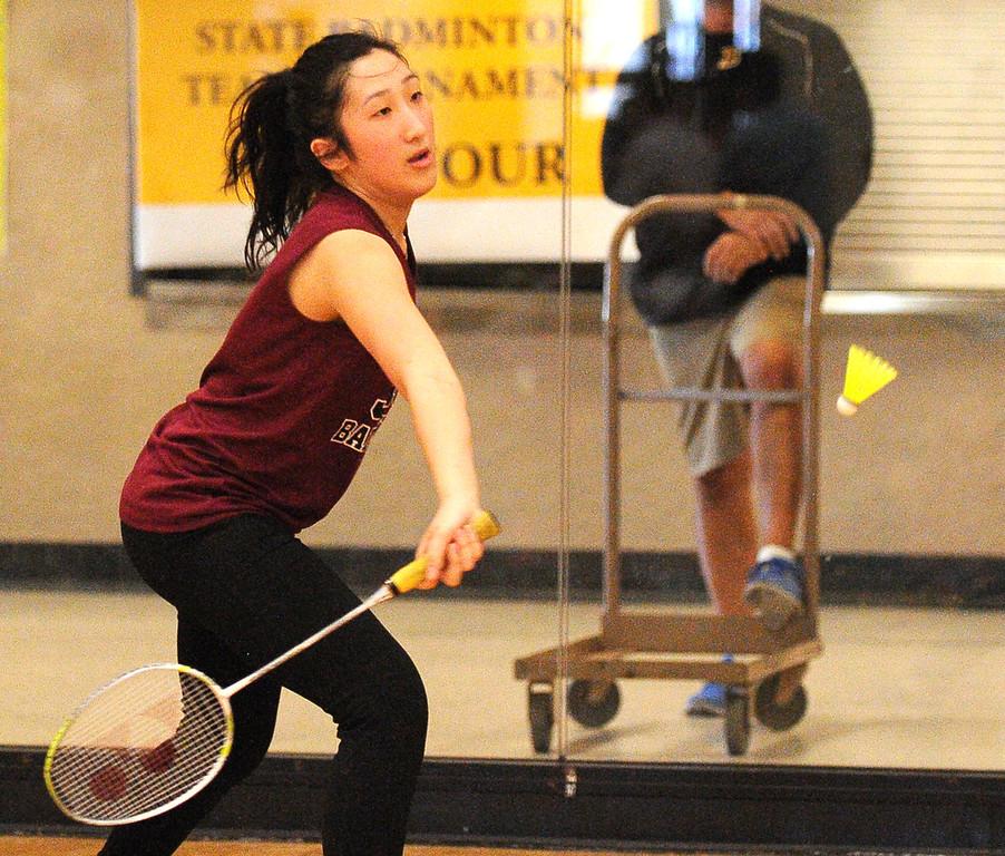 . Johnson senior Ka Lia Her returns a volley against Harding\'s Panyai Vue. Her won the match.   (Pioneer Press: John Autey)