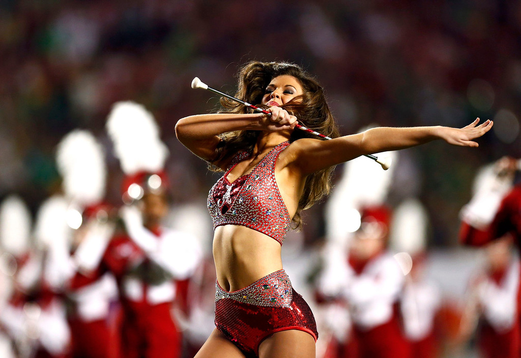. An Alabama Crimson Tide cheerleader performs ahead of the start of the NCAA National Championship college football game against the Notre Dame Fighting Irish in Miami, Florida, January 7, 2013. REUTERS/Chris Keane