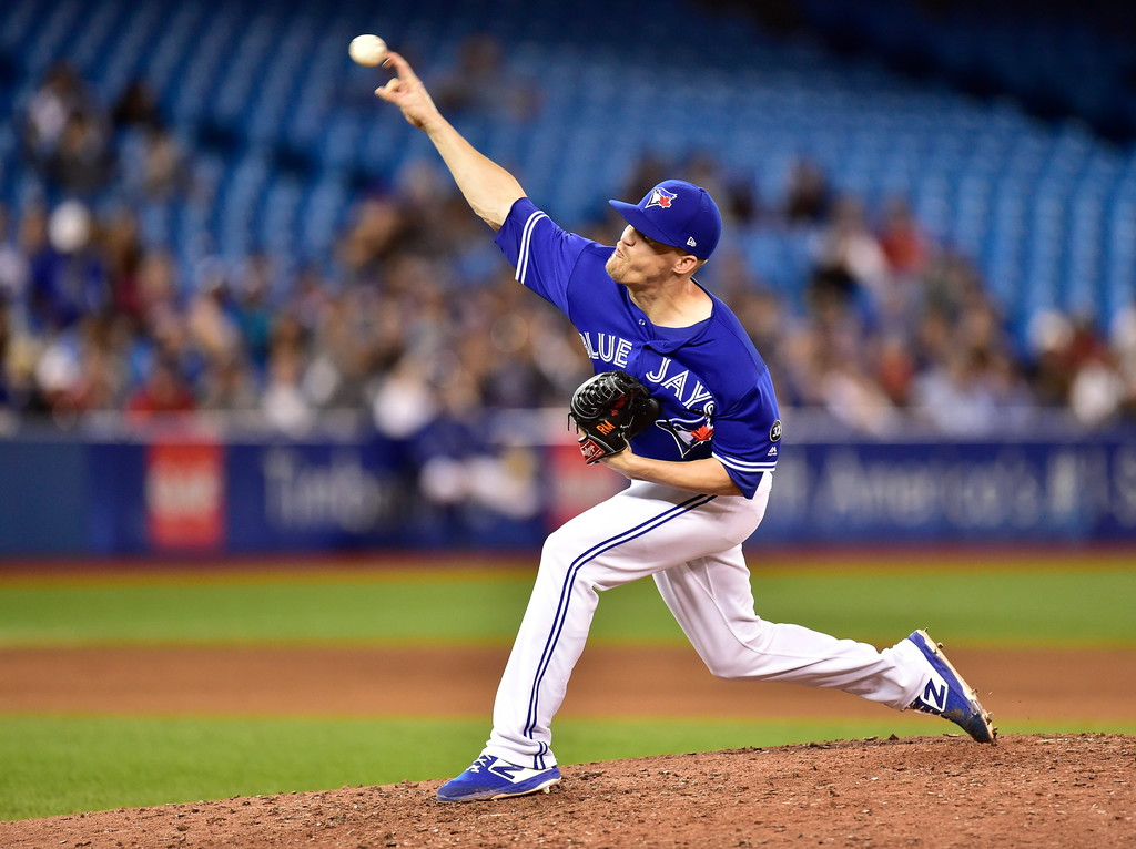 . Toronto Blue Jays relief pitcher Ken Giles throws against the Cleveland Indians during the ninth inning of a baseball game Friday, Sept. 7, 2018, in Toronto. (Frank Gunn/The Canadian Press via AP)