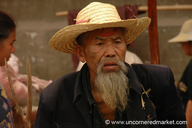 Older Man in Hat at Market - Guizhou Province, China