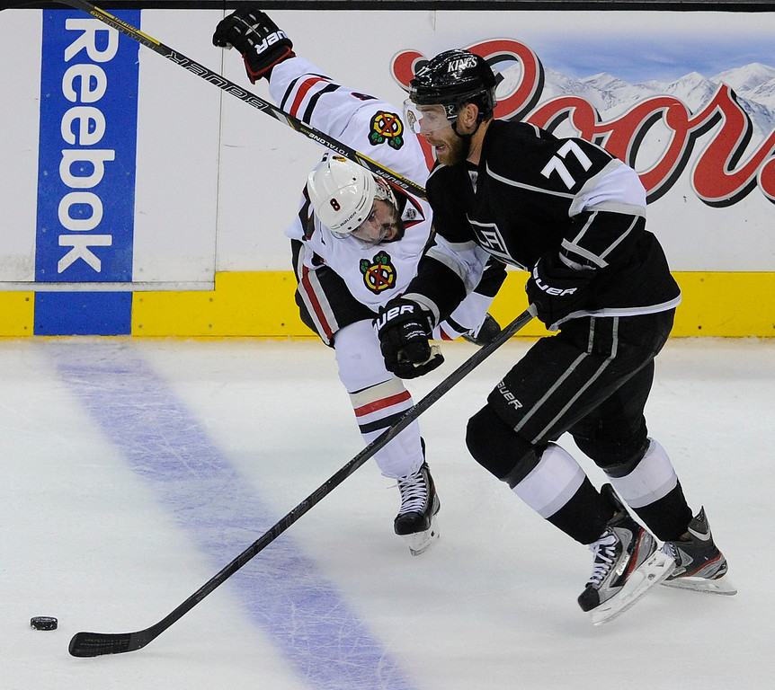 . Blackhawks#8 Nick Leddy and Kings#77 Jeff Carter battle for the puck in the 3rd period. The Kings defeated the Chicago Blackhawks in the 3-1 in the 3rd game of the Western Conference Finals. Los Angeles, CA 6/4/2013(John McCoy/LA Daily News4