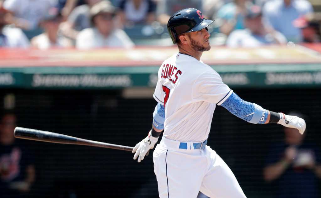 . Cleveland Indians\' Yan Gomes watches his three-run double in the third inning of a baseball game against the Minnesota Twins, Sunday, June 17, 2018, in Cleveland. Michael Brantley, Edwin Encarnacion and Lonnie Chisenhall scored on the play. (AP Photo/Tony Dejak)
