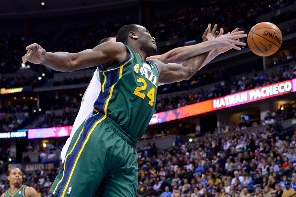 . Utah Jazz forward Paul Millsap (24) and Denver Nuggets center Kosta Koufos go after a rebound during the first quarter of an NBA basketball game on Saturday, Jan. 5, 2013, in Denver. (AP Photo/Jack Dempsey)