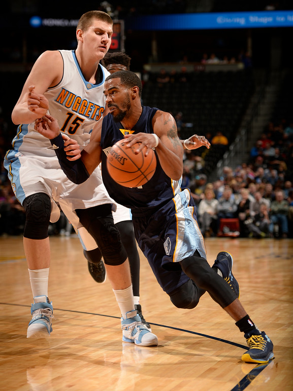 . DENVER, CO - FEBRUARY 29: Denver Nuggets center Nikola Jokic (15) puts pressure on Memphis Grizzlies guard Mike Conley (11) as he drives to the basket during the third quarter February 29, 2016 at Pepsi Center. (Photo By John Leyba/The Denver Post)