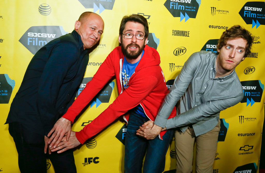 """. Mike Judge, from left, Martin Starr, and Thomas Middleditch pose on the red carpet for the world premiere of their television series  \""""Silicon Valley\"""" during the SXSW Film Festival on Monday, March 10, 2014, in Austin, Texas. (Photo by Jack Plunkett/Invision/AP)"""