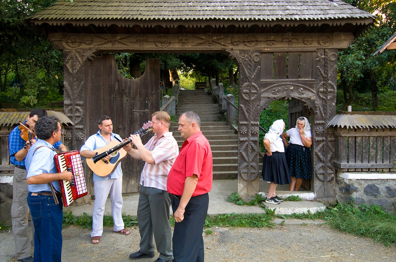 Village music band waiting for wedding party outside the church,