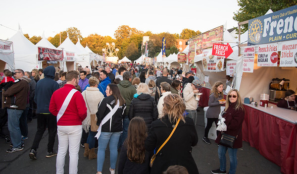 10/04/19 Wesley Bunnell | StaffrrA packed walkway lined with food booths on opening night at the Southington Apple Harvest Festival on Friday October 4, 2019.