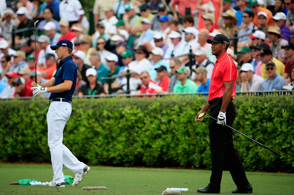. AUGUSTA, GA - APRIL 12:  Jordan Spieth (L)  and Tiger Woods of the United States work on the practice ground during the final round of the 2015 Masters Tournament at Augusta National Golf Club on April 12, 2015 in Augusta, Georgia.  (Photo by Jamie Squire/Getty Images)