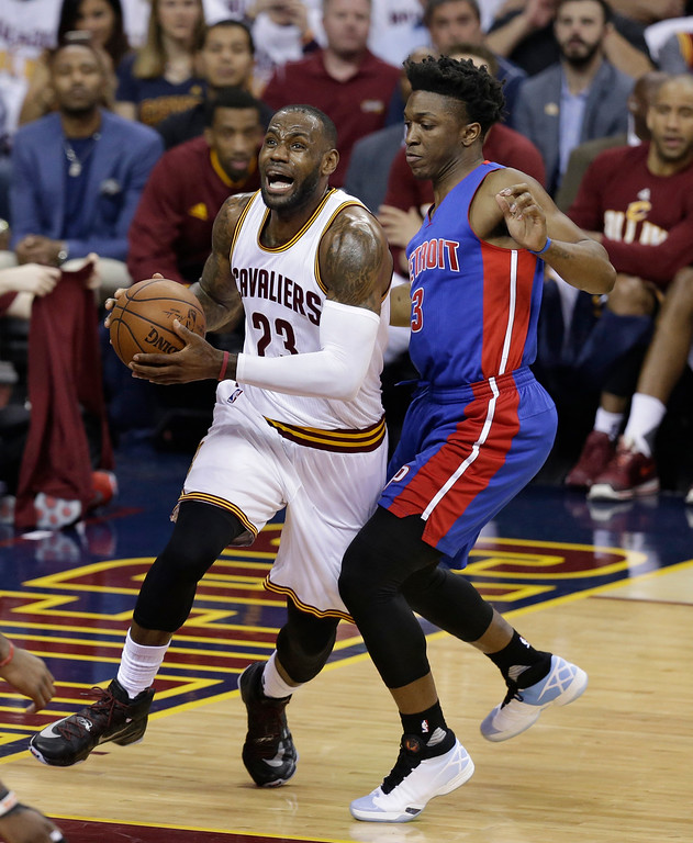 . Cleveland Cavaliers\' LeBron James (23) drives past Detroit Pistons\' Stanley Johnson (3) in the first half in Game 2 of a first-round NBA basketball playoff series, Wednesday, April 20, 2016, in Cleveland. (AP Photo/Tony Dejak)