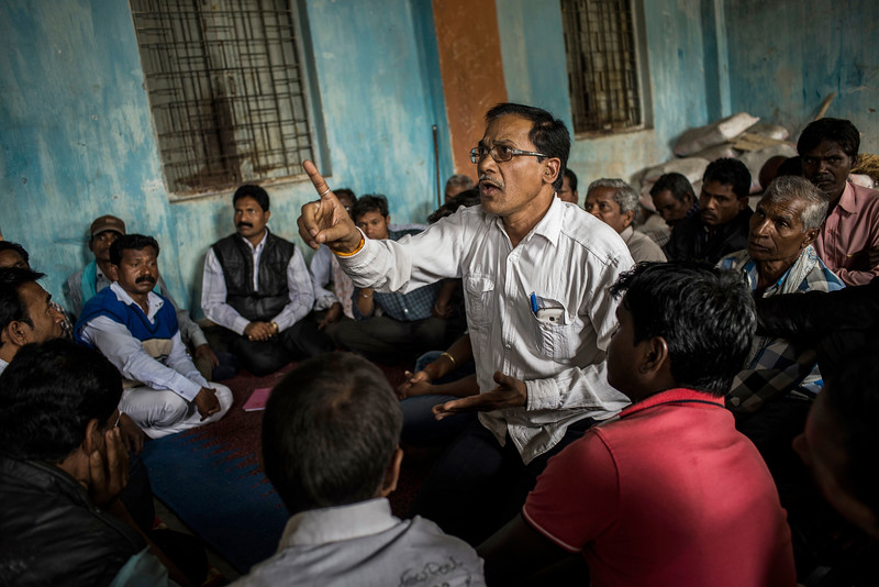 Chattisgarh, India, February 2015:   Community leaders from the village of Khodri discuss their plan of action for an upcoming  public hearing, in which government officials will hear the concerns of citizens from villages whose land is to be taken over by the coal mining companies for their proposed expansion.    Photographs for a story on land allocation for coal mines in Chattisgarh.  Modi's new government in the centre has relaxed the environmental regulations so the land can be allocated to both public and private sector companies easily.   Photo by Sami Siva for Al Jazeera America.