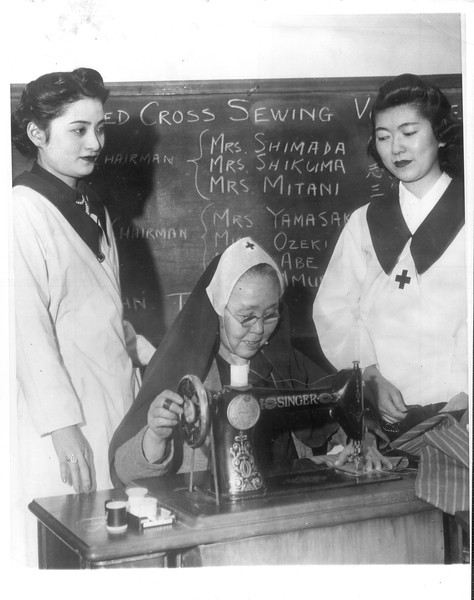 """""""Japanese-Americans sew for Red Cross.  Demonstrating their loyalty to this country, members of the Japanese-Alameda Citizens League of Alameda are working around the clock to produce garments for distribution to war victims"""" -- caption on photograph"""