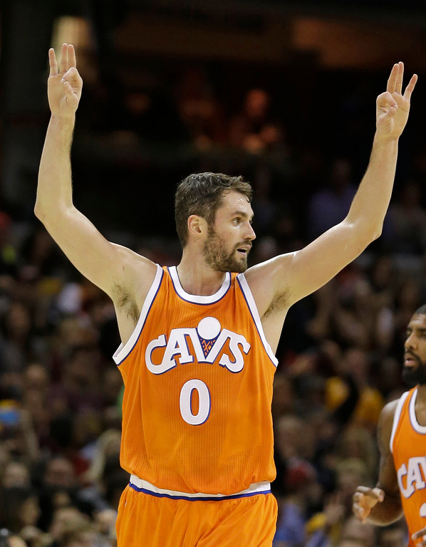 . Cleveland Cavaliers\' Kevin Love reacts after scoring a three-point shot in the second half of an NBA basketball game against the Miami Heat, Friday, Dec. 9, 2016, in Cleveland. (AP Photo/Tony Dejak)