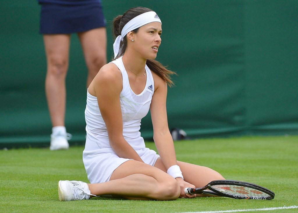 . Ana Ivanovic of Serbia reacts after losing a point during her women\'s singles tennis match against Virginie Razzano of France at the Wimbledon Tennis Championships, in London June 24, 2013.   REUTERS/Toby Melville