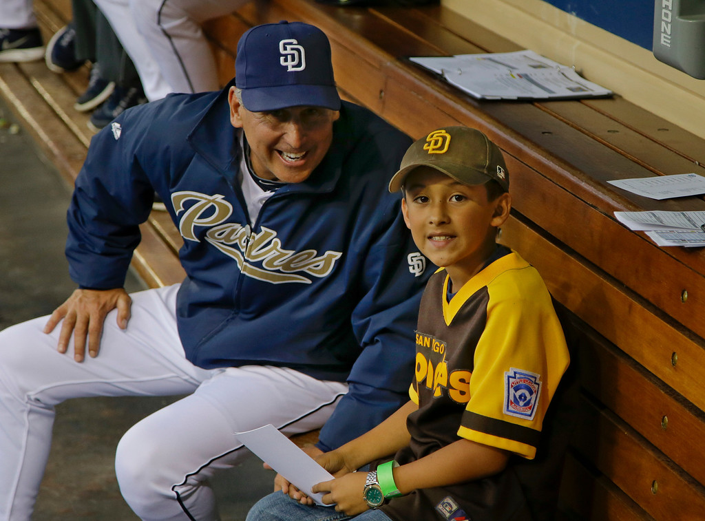 . San Diego Padres manager Bud Black sits with Abraham Zepeda , his line up assistant before the pair took the Padres starting lineup to home plate for the start of the Padres\' baseball game against the Los Angeles Dodgers in San Diego, Wednesday, April 10, 2013. (AP Photo/Lenny Ignelzi)