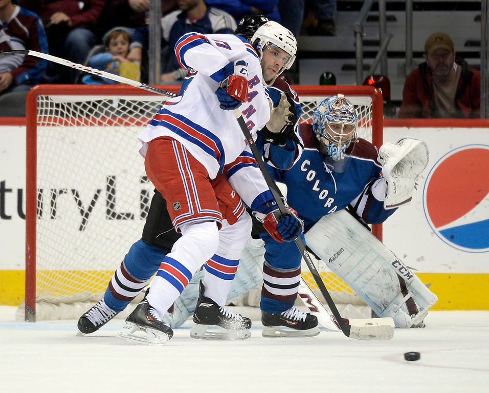 . New York wing Benoit Pouliot (67) pressured Colorado goalie Semyon Varlamov (1) in the first period.  (Photo by Karl Gehring/The Denver Post)