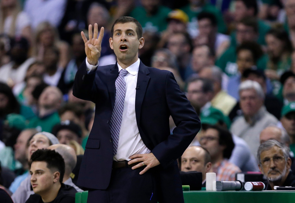 . Boston Celtics coach Brad Stevens gestures to his team during the first quarter of Game 5 of the NBA basketball Eastern Conference finals against the Cleveland Cavaliers, Wednesday, May 23, 2018, in Boston. (AP Photo/Charles Krupa)