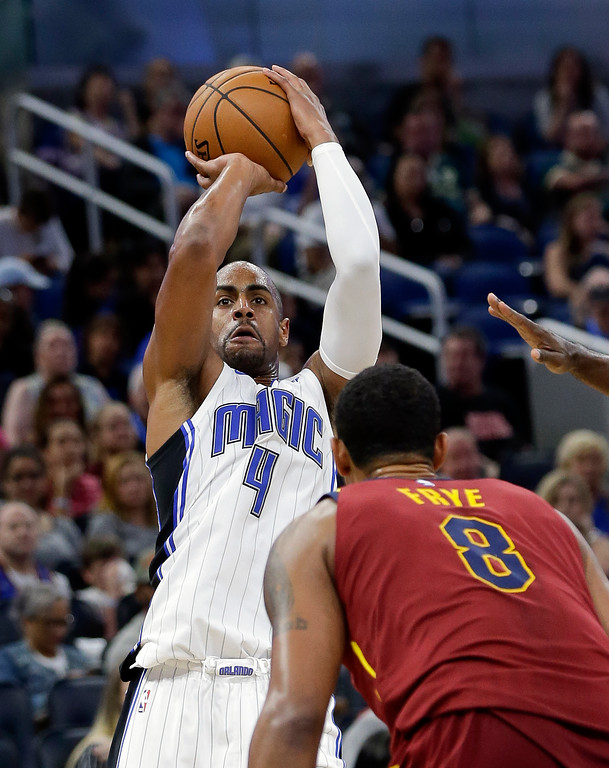. Orlando Magic\'s Arron Afflalo shoots over Cleveland Cavaliers\' Channing Frye (8) during the second half of an NBA preseason basketball game, Friday, Oct. 13, 2017, in Orlando, Fla. Cleveland won 113-106. (AP Photo/John Raoux)
