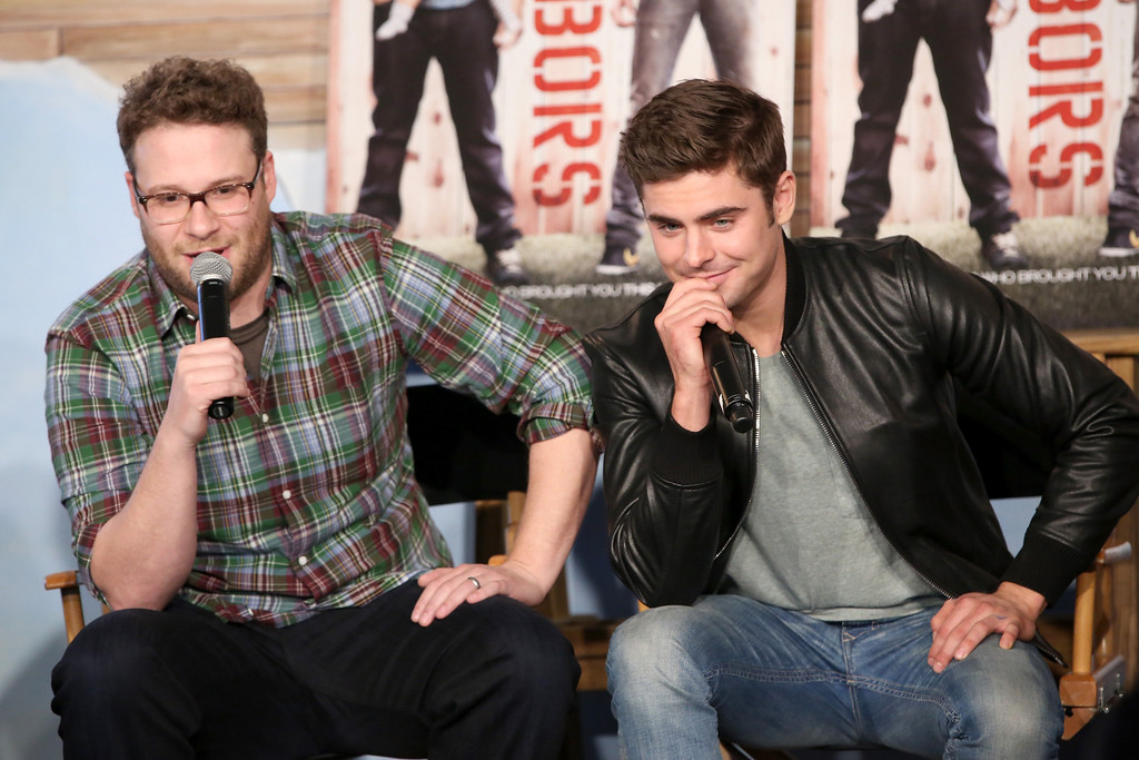 . Actors Seth Rogen (L) and Zac Efron attend Funny Or Die Clubhouse + Facebook Pop-Up HQ @ SXSW - Day 1 on March 8, 2014 in Austin, Texas.  (Photo by Jonathan Leibson/Getty Images)