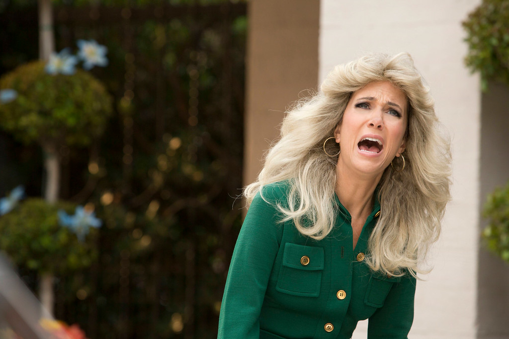 """. This image released by IFC TV shows Kristen Wiig as Cynthia Morehouse in a scene from \""""The Spoils of Babylon.\"""" Wiig was nominated for an Emmy Award for best actress in a miniseries or movie on Thursday, July 10, 2014. The 66th Primetime Emmy Awards will be presented Aug. 25 at the Nokia Theatre in Los Angeles. (AP Photo/IFC TV, Katrina Marcinowski)"""