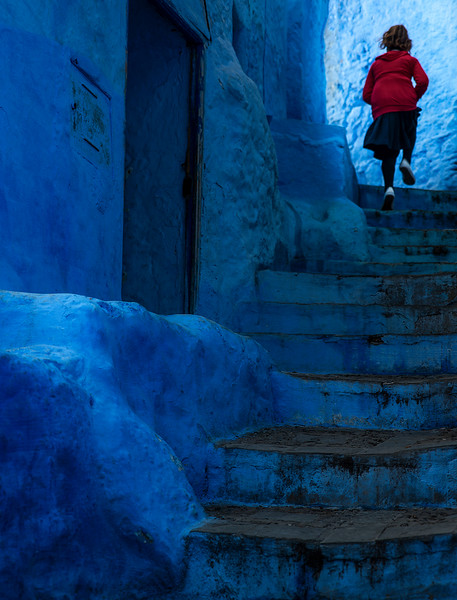 A child on her way to school in the blue city of Chefchaouen.  Chefchaouen, Morocco, 2018