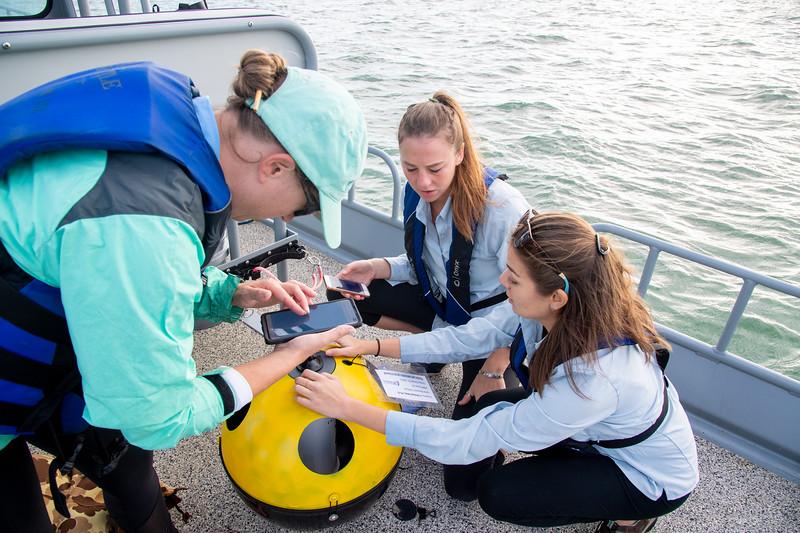 Elani Morgan (left), Lily Walker, and Tiffany Chin  prepare a new device.
