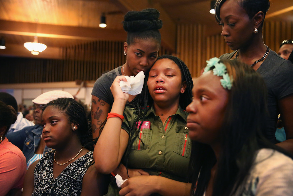 . ST. LOUIS, MO - AUGUST 12: A capacity crowd gathers at Greater St. Marks Family Church along with the family of Michael Brown and civil rights leader Rev. Al Sharpton to discuss the killing of Brown and the civil unrest resulting from his death on August 12, 2014 in St Louis, Missouri. Brown was shot and killed by a police officer on Saturday in the nearby suburb of Ferguson. Ferguson has experienced two days of violent protests since the killing but, tonight the town remained mostly peaceful.  (Photo by Scott Olson/Getty Images)