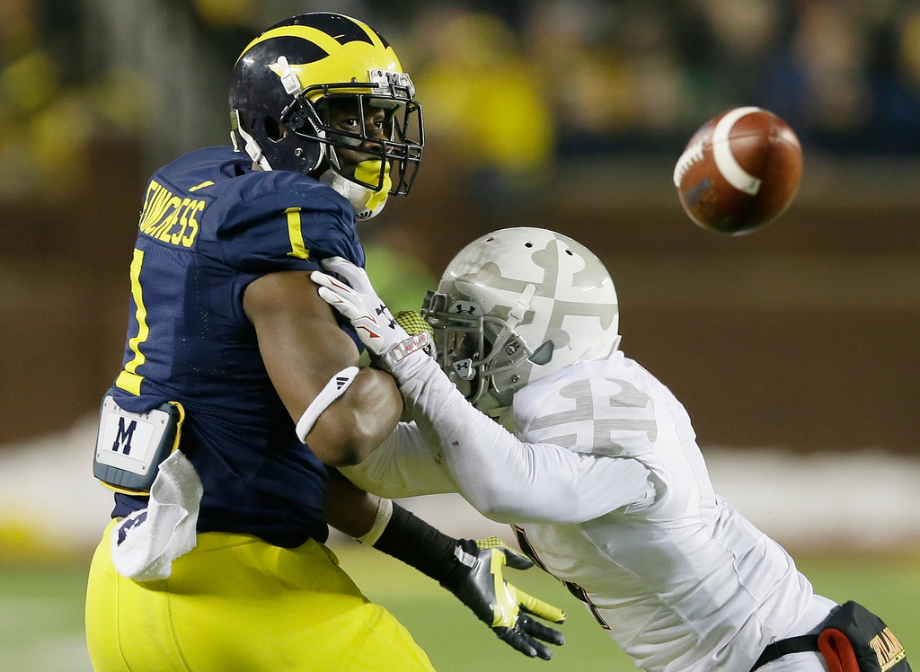 . Maryland defensive back William Likely (4) breaks up a pass intended for Michigan wide receiver Devin Funchess (1) during the second half of an NCAA college football game in Ann Arbor, Mich., Saturday, Nov. 22, 2014. (AP Photo/Carlos Osorio)