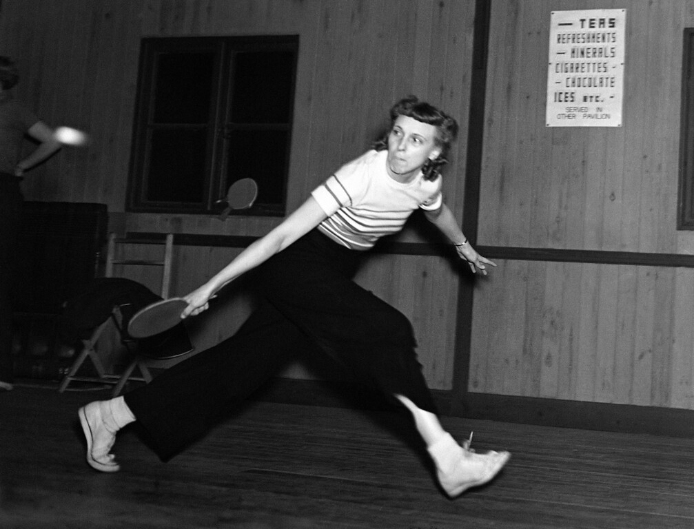 . Mildred Wilkinson, a member of the American table tennis team which has arrived in London for the World Table Tennis Championship, is seen in action during a practice match at the Bradix Club, Ealing, London, on Jan. 19, 1938.