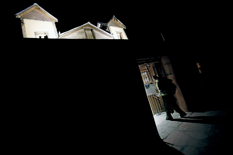 Nelson Tafoya, 52, of Peñasco, enters the Santuario de Chimayo at Midnight on Good Friday after walking 28 miles from Peñasco on Good Friday, April 19, 2019. This is Tafoya's 24th year taking the pilgrimage. Luis Sánchez Saturno/The New Mexican