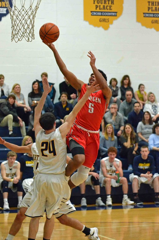 . Paul DiCicco - The News-Herald Hawken�s Ian Burrows with another drive to the hoop.