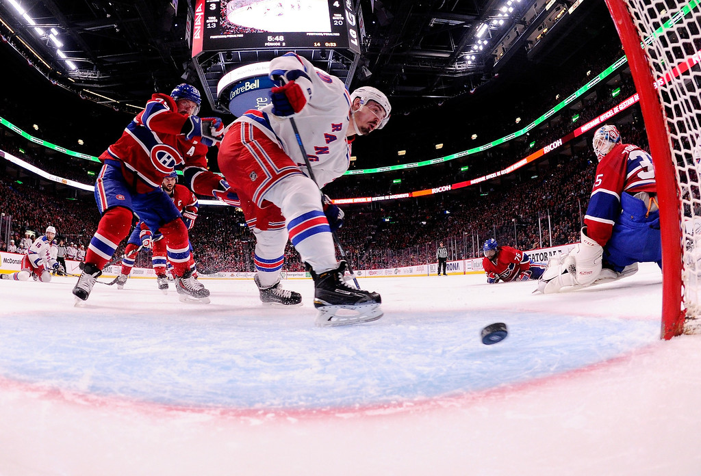 . Chris Kreider #20 of the New York Rangers shoots the puck into the net for a second period goal at 14:12 against the Montreal Canadiens during Game Five of the Eastern Conference Final in the 2014 NHL Stanley Cup Playoffs at Bell Centre on May 27, 2014 in Montreal, Canada.  (Photo by Richard Wolowicz/Getty Images)
