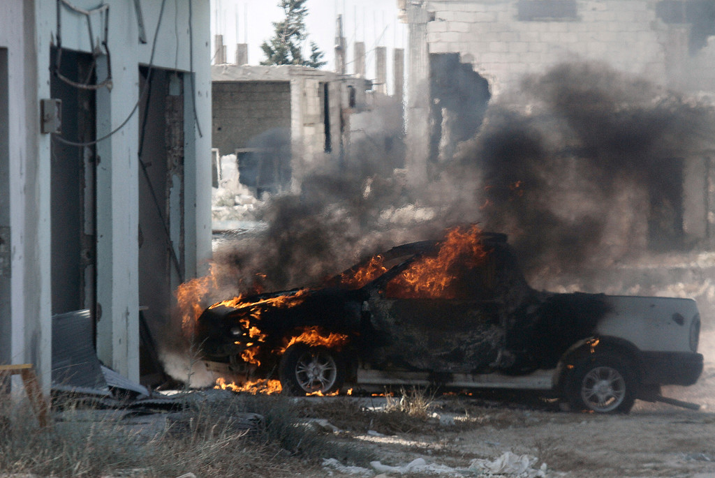 . A vehicle is seen burning in the village of Buweida, north of Qusayr, in Syria\'s central Homs province on June 7, 2013 as regime forces sought to mop up the final pockets of rebel resistance north of Qusayr, after retaking the key town that was an insurgent bastion for a year, a watchdog said. Qusayr\'s capture gives President Bashar al-Assad the upper hand if a US-Russian plan for the first direct peace talks with his opponents materialises, analysts say. STR/AFP/Getty Images