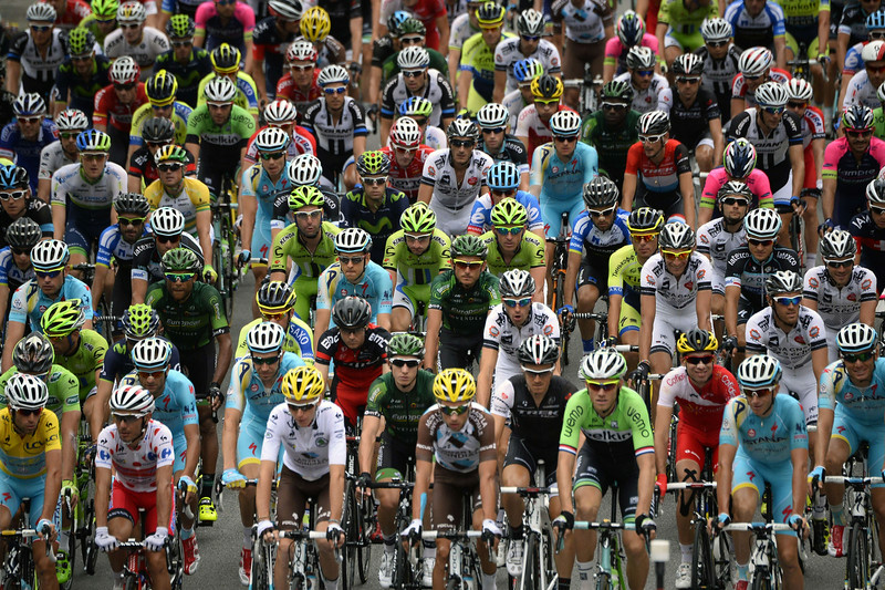 . (From L- bottom) Italy\'s Vincenzo Nibali wearing the overall leader\'s yellow jersey, Spain\'s Joaquim Rodriguez wearing the best climber\'s polka dot jersey, and France\'s Romain Bardet wearing the best young\'s white jersey take the start of the 177 km fourteenth stage of the 101st edition of the Tour de France cycling race on July 19, 2014 between Grenoble and Risoul, central eastern France.  (LIONEL BONAVENTURE/AFP/Getty Images)