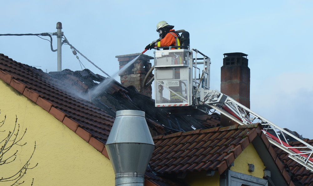 . Fire fighters work on the roof of a house to extinguish a fire that swept through an apartment building, killing at least seven people, including six children on early March 10, 2013 in Backnang, southwestern Germany. The cause of the blaze was not known but police said they were investigating an oven in a flat on the first floor of the former leather factory, hosting a German-Turkish cultural exchange association on the ground floor.  FRANZISKA KRAUFMANN/AFP/Getty Images