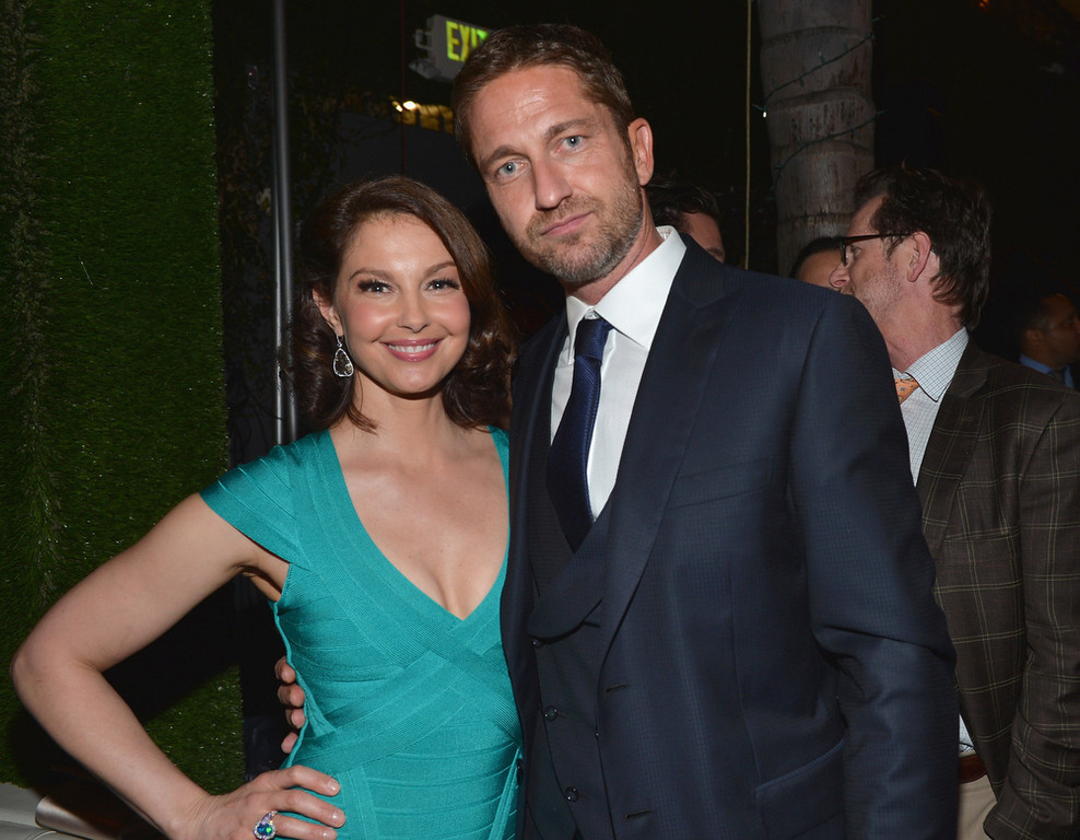 """. Actors Ashley Judd and Gerard Butler attend the after party for the premiere of FilmDistrict\'s \""""Olympus Has Fallen\"""" at Lure on March 18, 2013 in Hollywood, California.  (Photo by Alberto E. Rodriguez/Getty Images)"""