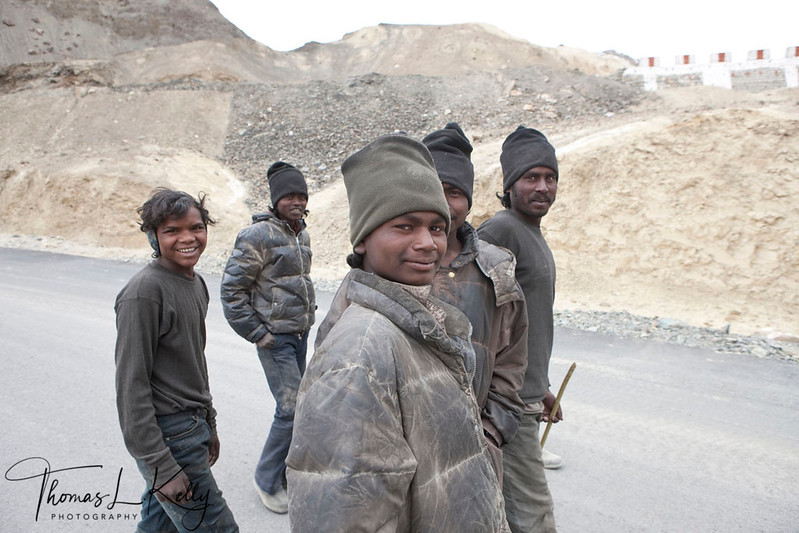 The road, for the most part, is a painstakingly handmade affair built and maintained by labourers from Bihar state of India. They are subjected to excruciating and extremely dangerous working conditions. The workers are woefully ill-equipped and under-dressed and although the army purports to lend them winter clothing suitable for the extremity of the weather at these altitudes, many of the workers were visibly suffering from the cold. Ladakh, India.