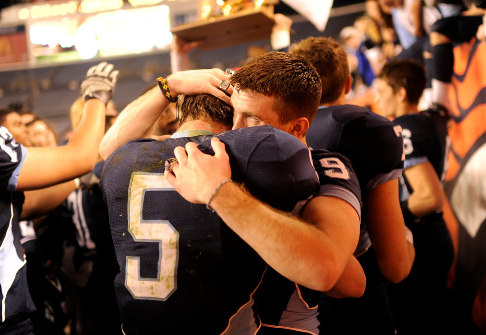 . Valor Christian RB Christian McCaffrey (5), left, and Cameron Gray celebrate winning the 5A State Championship game against Cherokee Trail at Sports Authority Field at Mile High on Saturday in Denver, CO on December 1, 2012. Hyoung Chang, The Denver Post