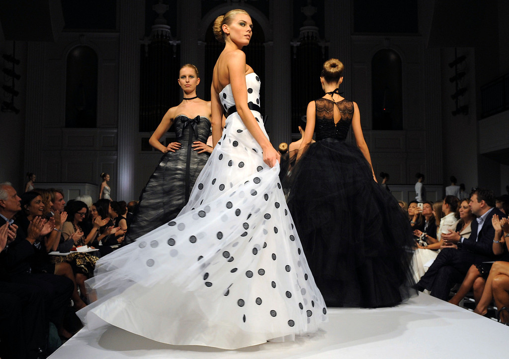 . n this Sept. 16, 2010, file photo, the finale of the Oscar de la Renta spring 2011 collection is modeled during Fashion Week in New York. (AP Photo/ Louis Lanzano, File)
