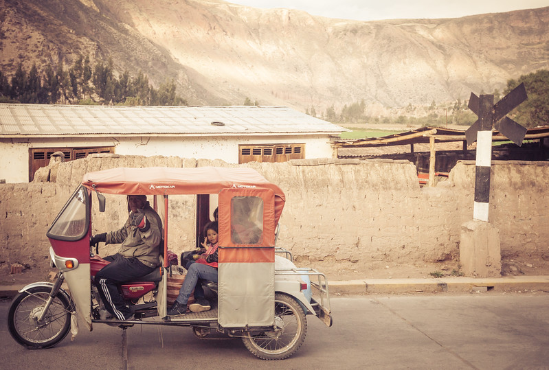 Waving to People in a Peruvian Motocar