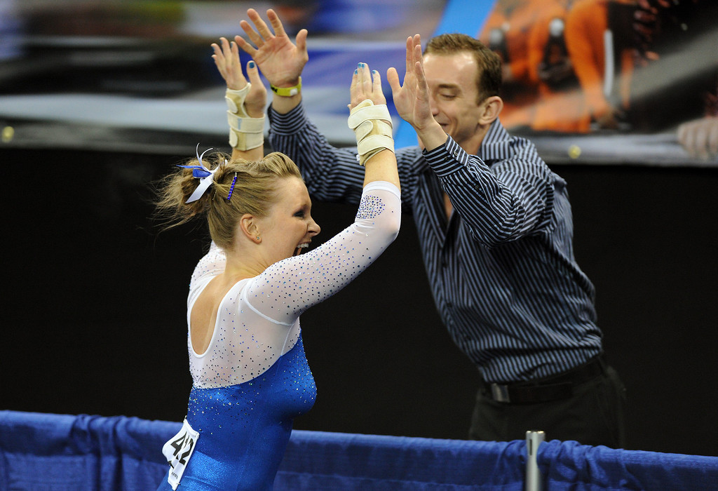 . Florida\'s Bridget Sloan is congratulated after competing in the vault at the NCAA Women\'s Gymnastics Championship Team Finals at Pauley Pavilion, Saturday, April 20, 2013. (Michael Owen Baker/Staff Photographer)
