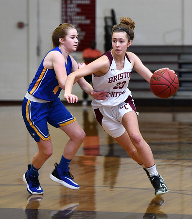 12/31/2019 MIke Orazzi | StaffrBristol Central's Ella Watson (23) and Gilbert's Kim McCarthy (4) during Tuesday's girls basketball game in Bristol.