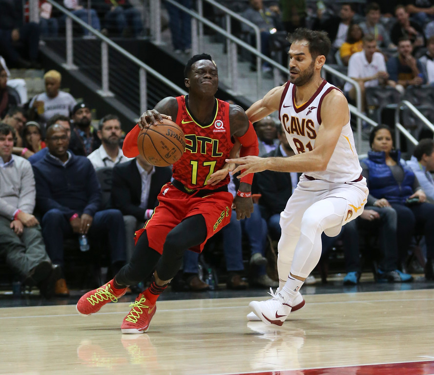 . Atlanta Hawks guard Dennis Schroder (17) drives past Cleveland Cavaliers guard Jose Calderon (81) in the first half of an NBA basketball game Thursday, Nov. 30, 2017, in Atlanta. (AP Photo/John Bazemore)