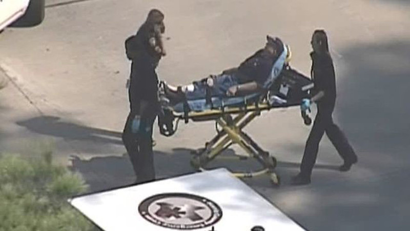 . Police and emergency personnel evacuate an injured male on a stretcher outside a building on the Lone Star College Campus near Houston, Texas in this still image taken from video courtesy of KPRC-TV Houston January 22, 2013.  Multiple people have been shot according to news reports.  REUTERS/KPRC-TV Houston/Handout