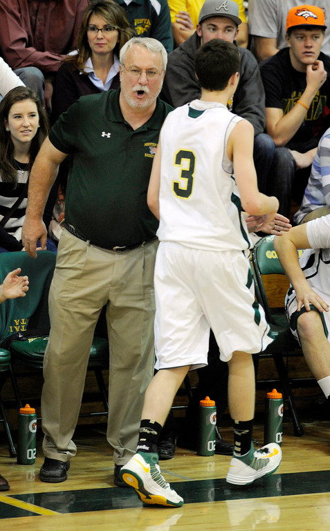 . Mountain Vista coach Bob Wood rested guard Jake Pemberton (3) in the second half. The Mountain Vista High School boy\'s basketball team defeated Arapahoe 69-54 Friday night January 4, 2013.  Karl Gehring/The Denver Post